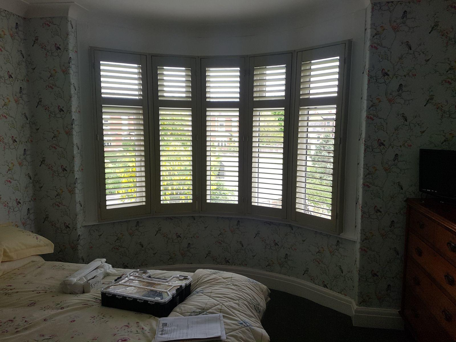 Curved bay window install absolute plantation shutters for Bay window installation